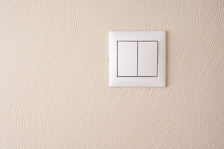 interior walls: Double gang switch on the wall with beige vinyl wallpaper                   Stock Photo