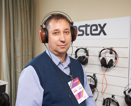 high end: Moscow Hi Fi and High End Show, Moscow, Russia - April 15, 2016: Visitor of the show with stereo headphones