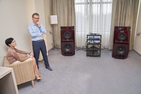 high end: Moscow Hi Fi and High End Show, Moscow, Russia - April 15, 2016: Alexey Slonov and his audio system Slonov Sound Design in the show room