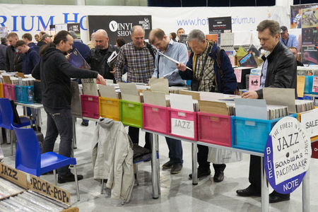high end: Moscow Hi Fi and High End Show, Moscow, Russia - April 15, 2016: Vinyl sales as part of the show, people sell and buy music plates of variety of jenres.