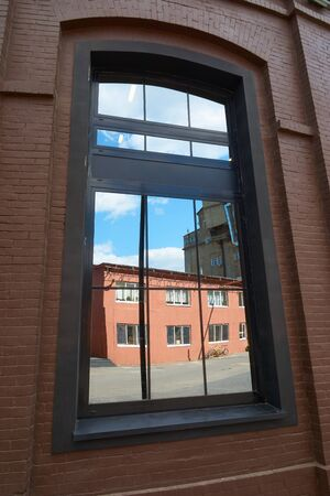 arma: Reflection of red building in the window. Arma, Nizhniy Susalniy pereulok (lane) in Moscow.