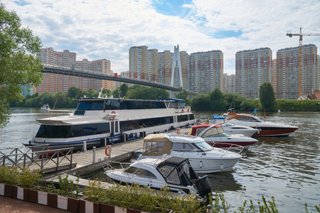 motorboats: View on Spasskiy bridge and motorboats on Moskva river near Myakinino metro station and Crocus Expo in summer