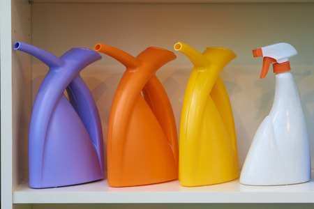 four objects: Three watering cans and one spray for watering flowers