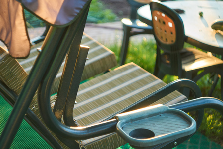 swing seat: Outdoor garden swing seat shot with shallow depth of field Stock Photo