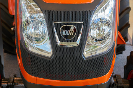 grille: Moscow, Russia - August 25, 2016: Radiator grille of the Kioti tractor with headlights on display at Moscow Flower show 2016 Editorial