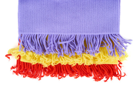 Red, violet and yellow scarves isolated on white