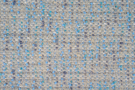 Piece of knitted fabric with blue yarn as a seamless background