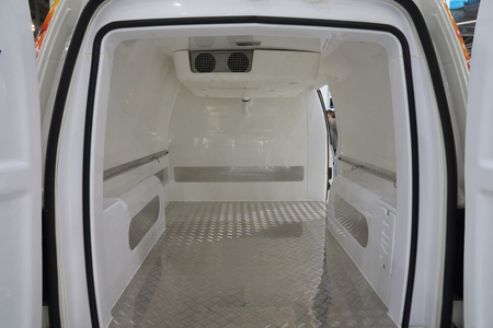 White interior of the cargo area of the new fridge van. Refrigeration unit inside. Banco de Imagens