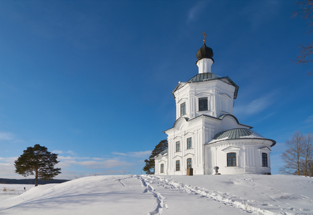 Winter view on the Church of the exaltation of the holy cross in the monastery of the Nilo-Stolobenskaya Pustyn, Ostashkov district, Tver oblast, Russia. Stok Fotoğraf