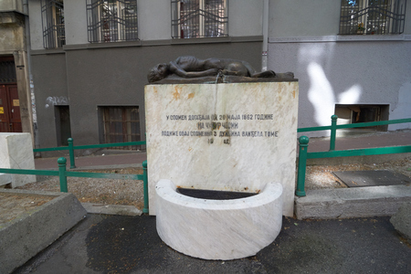 Belgrade, Serbia - May 02, 2018: Drinking water fountain and monument on Dobracina street. Serbian text says that this monument is dedicated to the memory of the events of May 26, 1862.