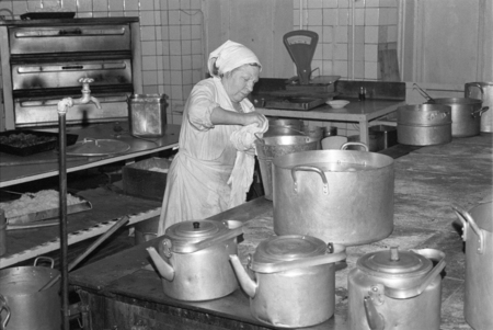 Moscow, USSR - November 23, 1989: Canteen in the Ministry of the Automotive Industry of the USSR. Elderly woman works in the kitchen of the canteen