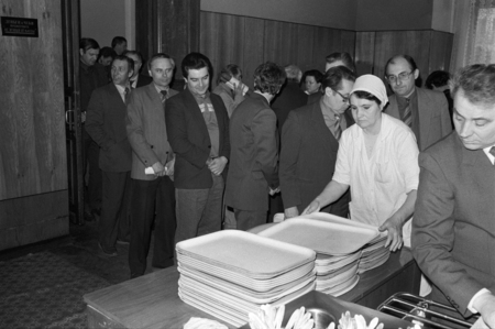 Moscow, USSR - November 23, 1989: Canteen in the Ministry of the Automotive Industry of the USSR. Employees queue to get meals. Canteen worker puts clean trays. Редакционное
