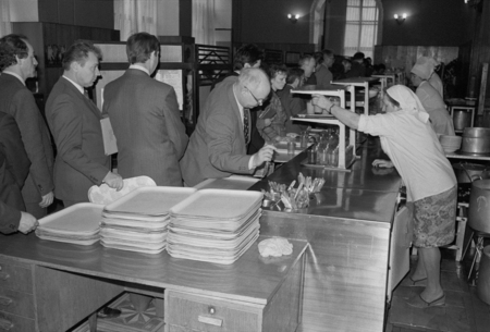 Moscow, USSR - November 23, 1989: Canteen in the Ministry of the Automotive Industry of the USSR. Employees queue to get meals. Canteen workers serve food.