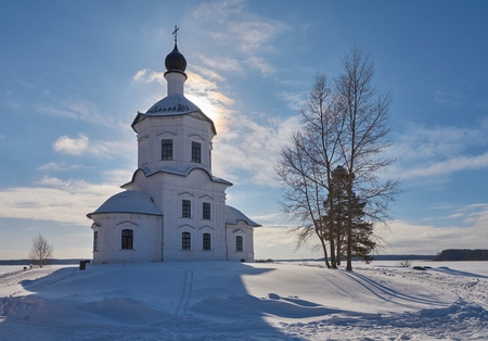Winter view on the Church of Exaltation of the Holy Cross in russian orthodox monastery of the Nilo-Stolobenskaya Pustyn, Ostashkov district, Tver oblast, Russia. It is situated on Stolobny island of Seliger lake. Stok Fotoğraf - 115725220