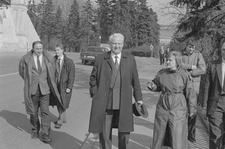 Moscow, USSR - March 28, 1991: Chairman of the Presidium of the Supreme Soviet of the Russian SFSR Boris Nikolayevich Yeltsin walks outdoors in Kremlin with his bodyguards and associates. Editöryel