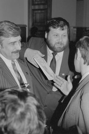 Moscow, Russia - March 28, 1991: Peoples deputies in Kremlin. Peoples deputy on the left is unidentified. Peoples deputy in the centre is Evgeniy Vladimirovich Kogan. He represented Estonia.