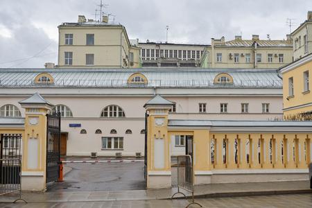 Moscow, Russia - March 22, 2019: View of Manezhnaya street. Blue address plaque: Maneznaya street.