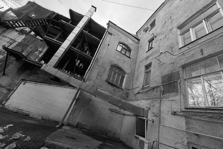 Moscow, Russia - March 23, 2019: Black and white image shot by the wide angle lens of house on Arbat street Editöryel