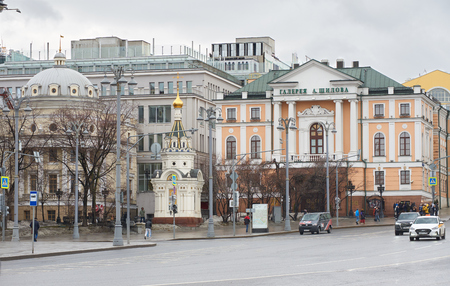 Moscow, Russia - March 22, 2019: Alexander Shilov Moscow State Picture Gallery on the right and Nikolai Chudotvorets chapel on the left. Russian text on the right building: A. Shilov gallery.