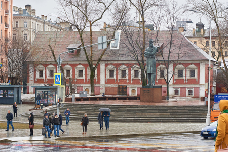 Moscow, Russia - March 22, 2019: Ploshchad Prechistenskiye Vorota square, monument to Friedrich Engels and Red Chambers historical building