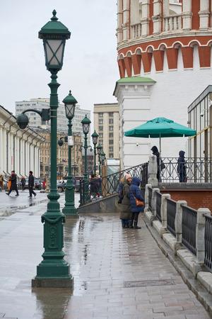 Moscow, Russia - March 22, 2019: Street lamps on Manezhnaya street and Kutafiya (Predmostnaya) Tower on the right.