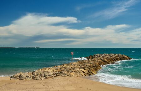 Seascape, sand beach and breakwater in Cannes, French Riviera, France. 스톡 콘텐츠