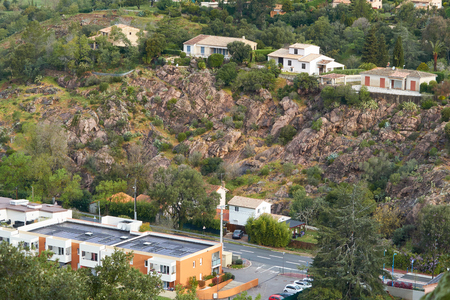 View on houses on the rocky slope of the mountain in Mandelieu-La Napoule, French Riviera, France 에디토리얼