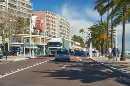 Cannes, France - April 04, 2019: Beautiful houses on Boulevard du Midi Jean Hibert. There is sea on the right.