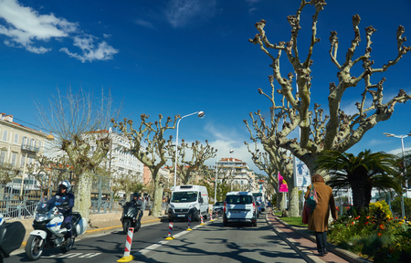 Cannes, France - April 04, 2019: Driving on Prom. de la Pantiero. There is sea on the right. 에디토리얼