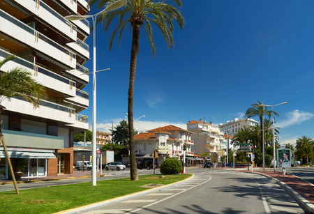Cannes, France - April 04, 2019: Beautiful architecture on Boulevard de la Croisette. There is sea on the right.