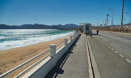 Cannes, France - April 04, 2019: Sea, sand beach and Boulevard du Midi Louise Moreau on the right 에디토리얼