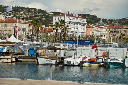 Cannes, France - April 04, 2019: View on boats in old port and Splendid Hotel Cannes
