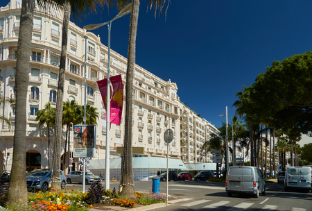 Cannes, France - April 04, 2019: Beautiful Miramar hotel on Boulevard de la Croisette. There is sea on the right.