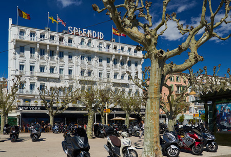 Cannes, France - April 04, 2019: Beautiful Splendid Hotel Cannes on Boulevard du Midi Jean Hibert. There are always lots of motocycles on this square.