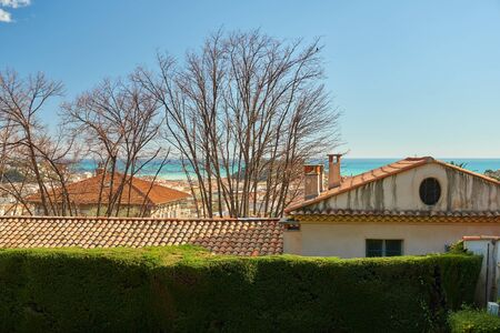 View on tiled roofs of Nice and sea from Monastere de Cimiez Garden in Nice, France.
