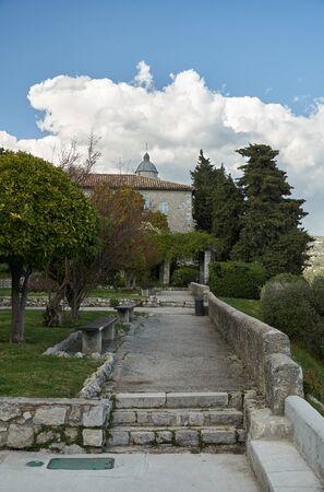 Stone walkway in the Monastere de Cimiez Garden in Nice, France.