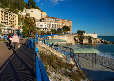 Nice, France - April 04, 2019: Evening view of Nice, Bellanda tower, hotel Suisse and sea on the right.