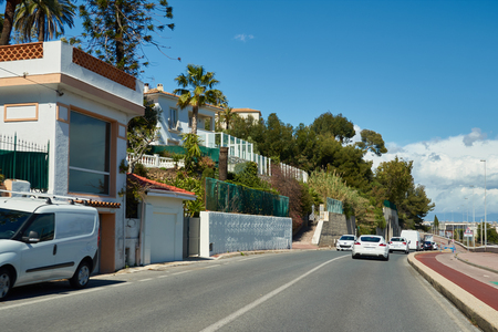 Cannes, France - April 04, 2019: On the road between Cannes and Nice. Bicycle lane and railroad are on the right. Editorial