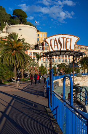 Nice, France - April 04, 2019: Evening view of Nice, Bellanda tower, hotel Suisse and sign of Castel plage restaurant.