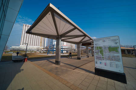 Moscow, Russia - March 07, 2020: Partizanskaya transport hub with a glass canopy at the bus stop and information stand with maps. Editorial
