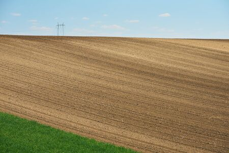 Angle view of plowed field in Serbia in spring Standard-Bild