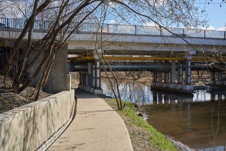 Vtoroy Medvedkovskiy most bridge in Moscow over Yauza river and pedestrian walkway under it in springtime