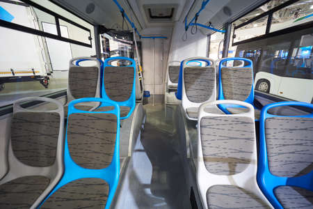 Interior of modern bus with passenger seats