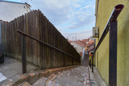 Wide angle view of wooden fence and stone stairs in Zemun old part of Belgrade