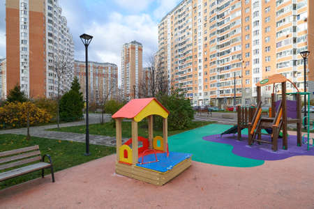 Moscow, Russia - November 07, 2020: Playground with children's slide and blocks of flats Raduzhnaya street in New Moscow.