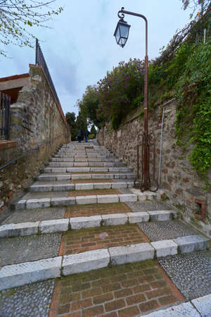 Stone stairs and metal gate on old street Rue Coste Corail in Cannes, France