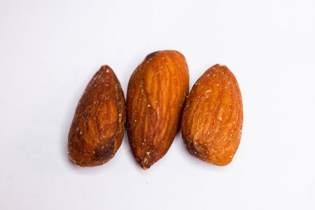 Three close-up shot of three salted roasted almonds Stok Fotoğraf