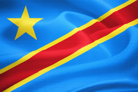 zaire: flag of the Democratic Republic of the Congo waving in the wind. Silk texture pattern Stock Photo
