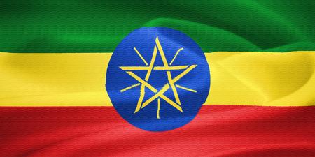 rastafari: Flag of Ethiopia waving in the wind. Silk texture pattern Stock Photo