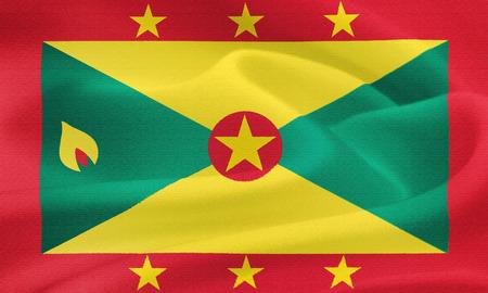saint george: flag of Grenada waving in the wind. Silk texture pattern